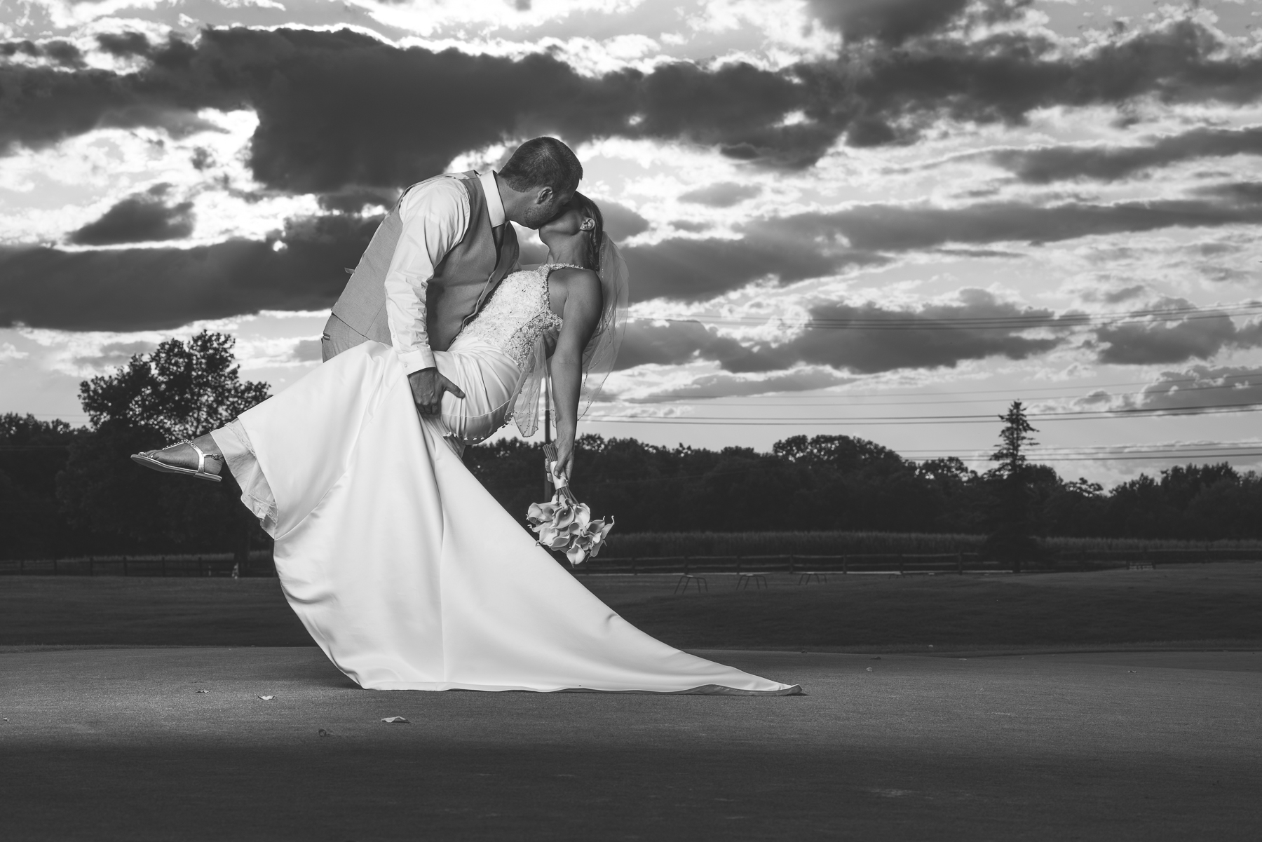 Black and white wedding photo on the Bridges Golf Course at sunset.