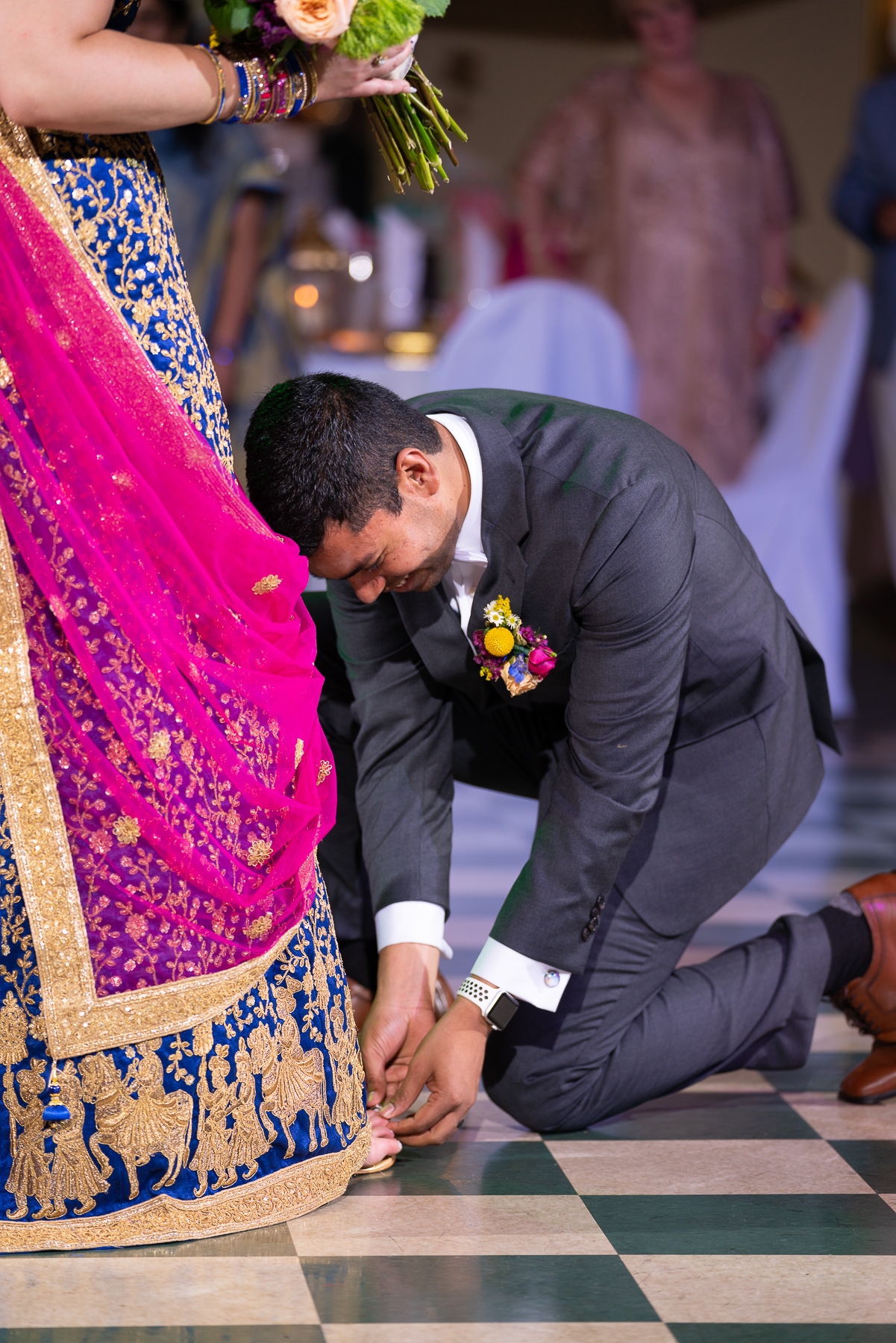 The Groom placing the toe ring on his new Bride. We enjoyed learning about this tradition of his Indian Culture.