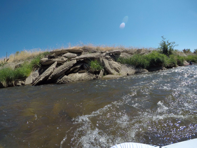 Flood debris and concrete riprap along south bank does not provide adequate habitat.