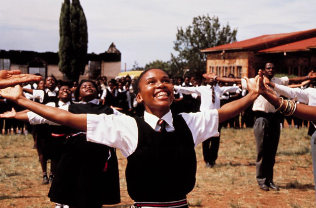 Libra:     Sarafina!  (1992)    directed by Darrell Roodt   Libra, as we move into your season, may we all feel a profound sense of balance within our lives. Represented by the scales of justice, Libras are known for being fair and peaceful.  Sarafina!  is the perfect film for you to watch during your birthday month, as it will both spark your never ending quest for what is right, but it will also indulge your love of all that is visually beautiful. Set in apartheid South Africa , the film centers around a school girl, Sarafina (Leleti Khumalo), who is moved to act against the deep injustices around her after her beloved teacher, Mary Mosumbuka (the delightful Whoopi Goldberg) is imprisoned for her participation in the resistance. Despite the upsetting subject matter of the film,  Sarafina!  is puzzlingly a musical, creating a juxtaposition that Libras might relate to. Though your heart always seeks righteousness, Libra, you have a difficult time approaching conflict head-on, instead creating change through diplomacy and your calm disposition. Sarafina moves through the world in a similar way; never indifferent to the atrocities of the world, but also never without hope and love. May this film inspire you to take on a new cause and to never be afraid to speak out against bigotry and ignorance.