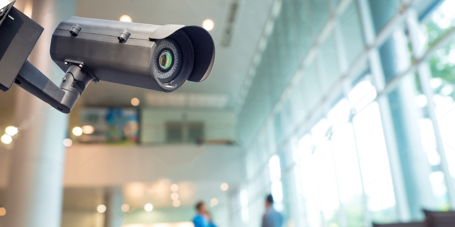 stock-photo-security-cctv-camera-or-surveillance-system-in-office-building-360214781.jpg