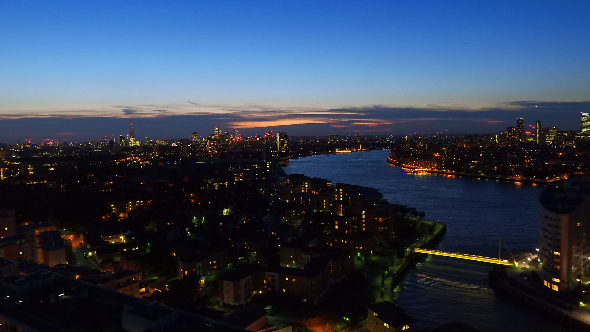 Stunning night time views towards central London with The Shard and the London Eye visible on the horizon.