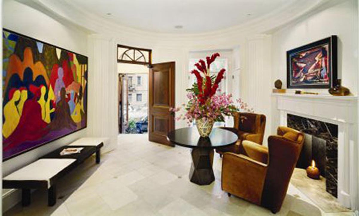 Modern style entry with two brown chairs