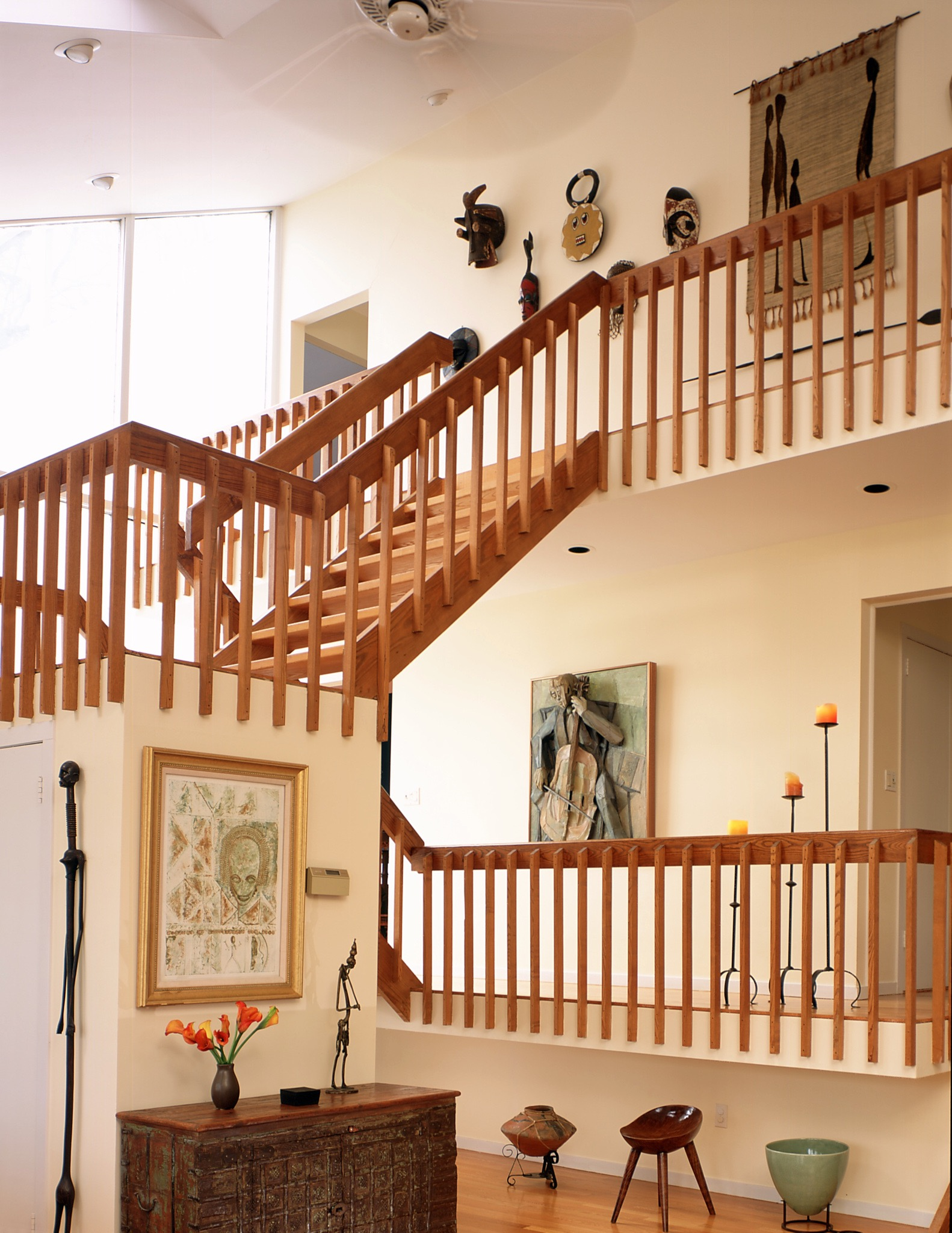 Modern entry with wooden stairway