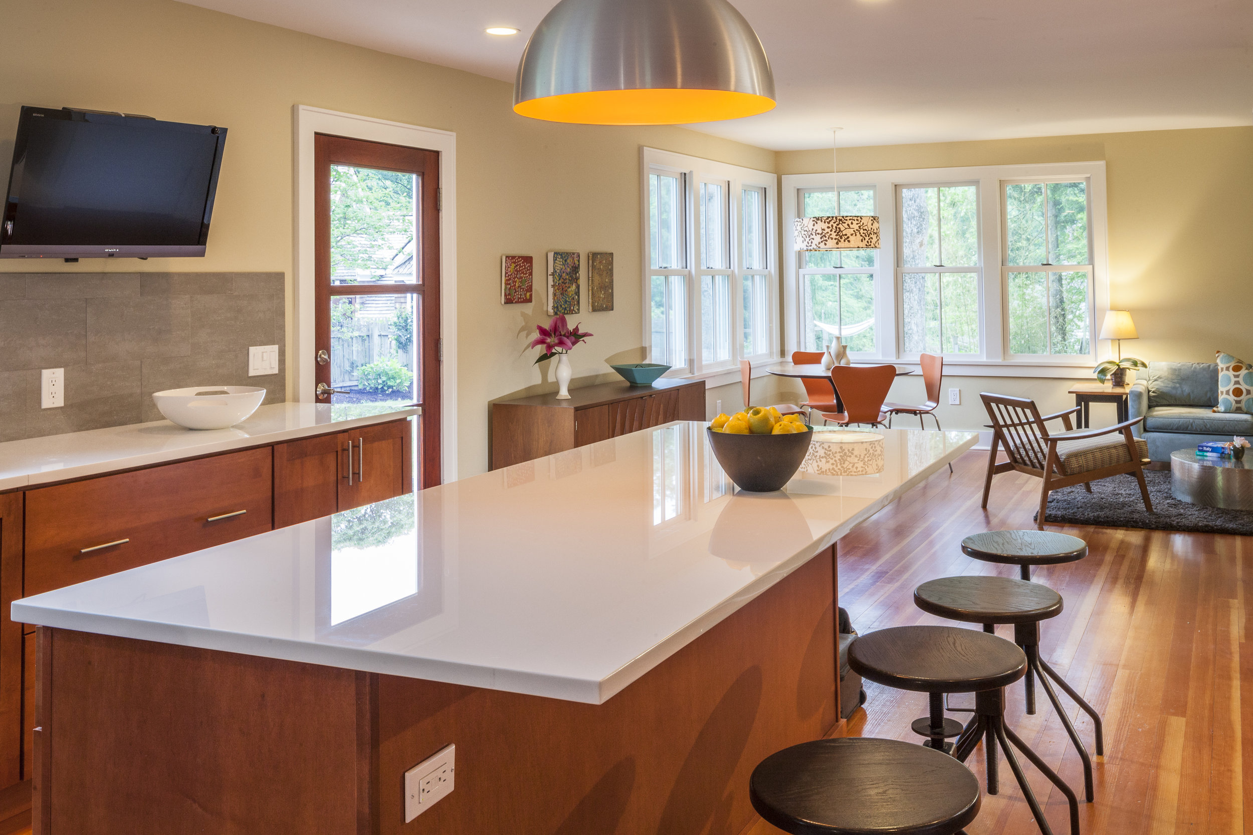 Modern, bright kitchen interior with chairs and kitchen island
