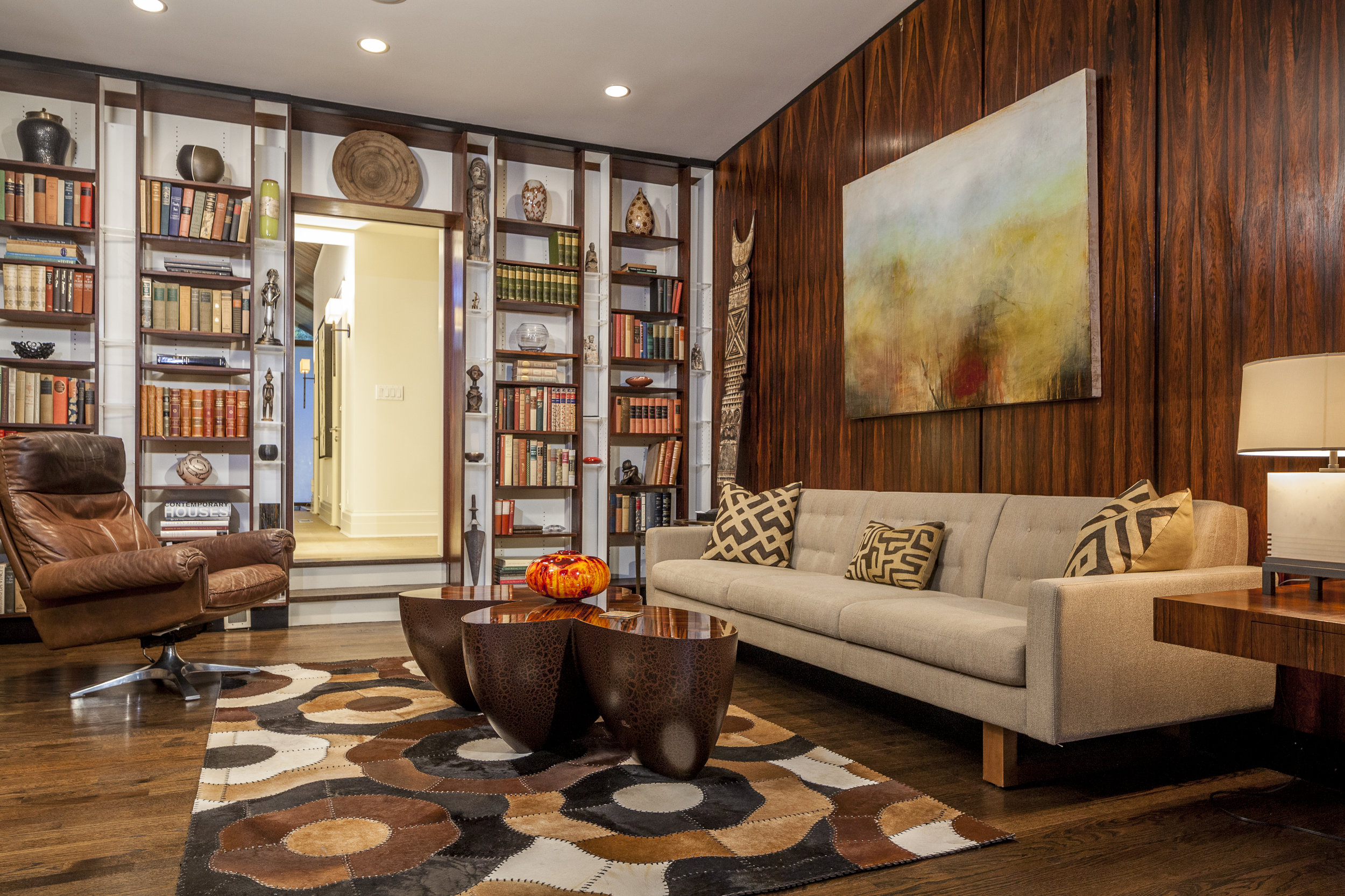 Family room with books and sofa and wooden table
