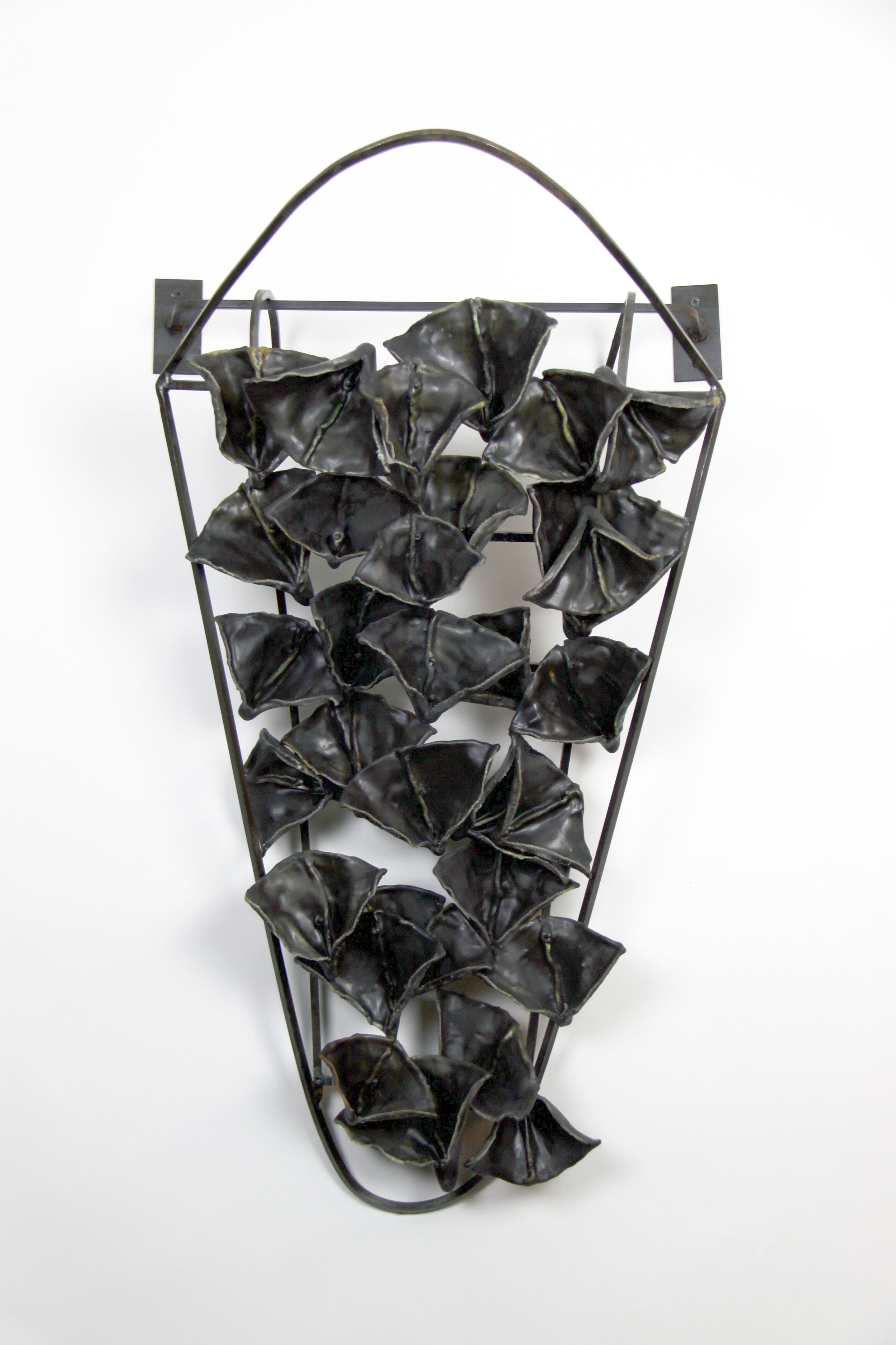 Cradle, 2005, Waxed cloth, welded steel, 32x18x12 inches
