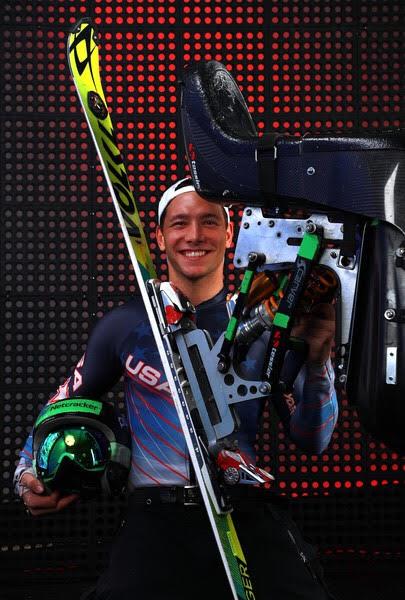 Andrew Kurka Sitting with Ski.jpg
