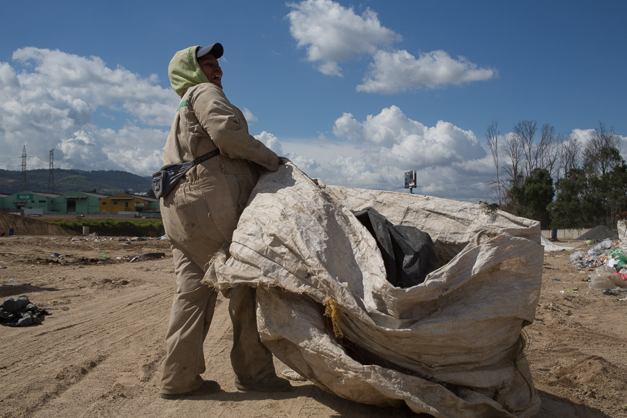 A guajero readies her collection bags for a day of waste picking.  ©Cindy Bajema 2014
