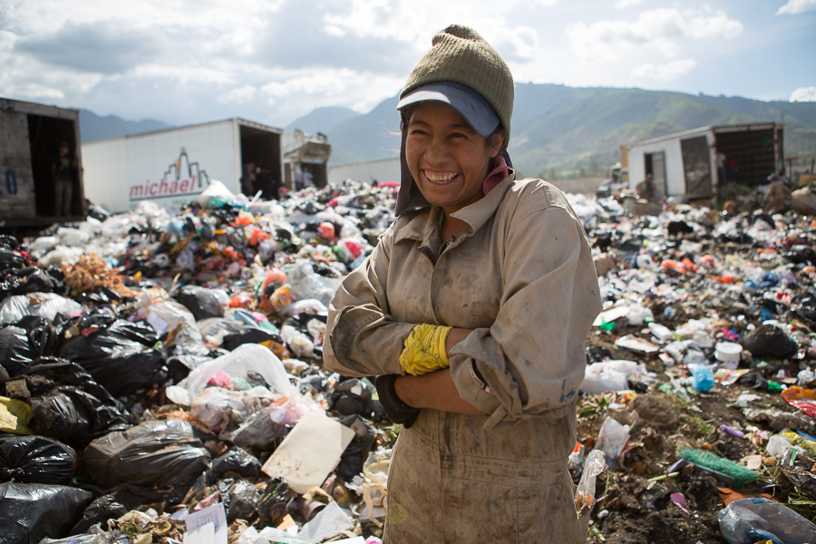 "Gabriel Calderon, a 21 year old ""guajero"" or waste picker has been working at the AMSA landfill for 3 years. She collects bottles, plastic, different types of metal and paper. She generally earns about 150 Quetzales a day (approximately $19 US) and is grateful to be working at the AMSA landfill.  ©Cindy Bajema 2014"