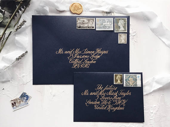 Classic script for tradition lovers - This handwritten calligraphy is perfect for regal stately home weddings. By choosing a light or metallic ink, however, you can go against tradition with a dark shade for your envelope such as navy, burgundy or even black.