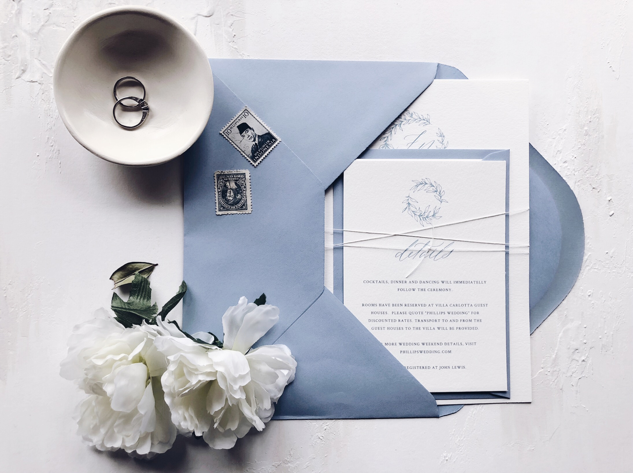 Foliage wedding invitations with calligraphy detail