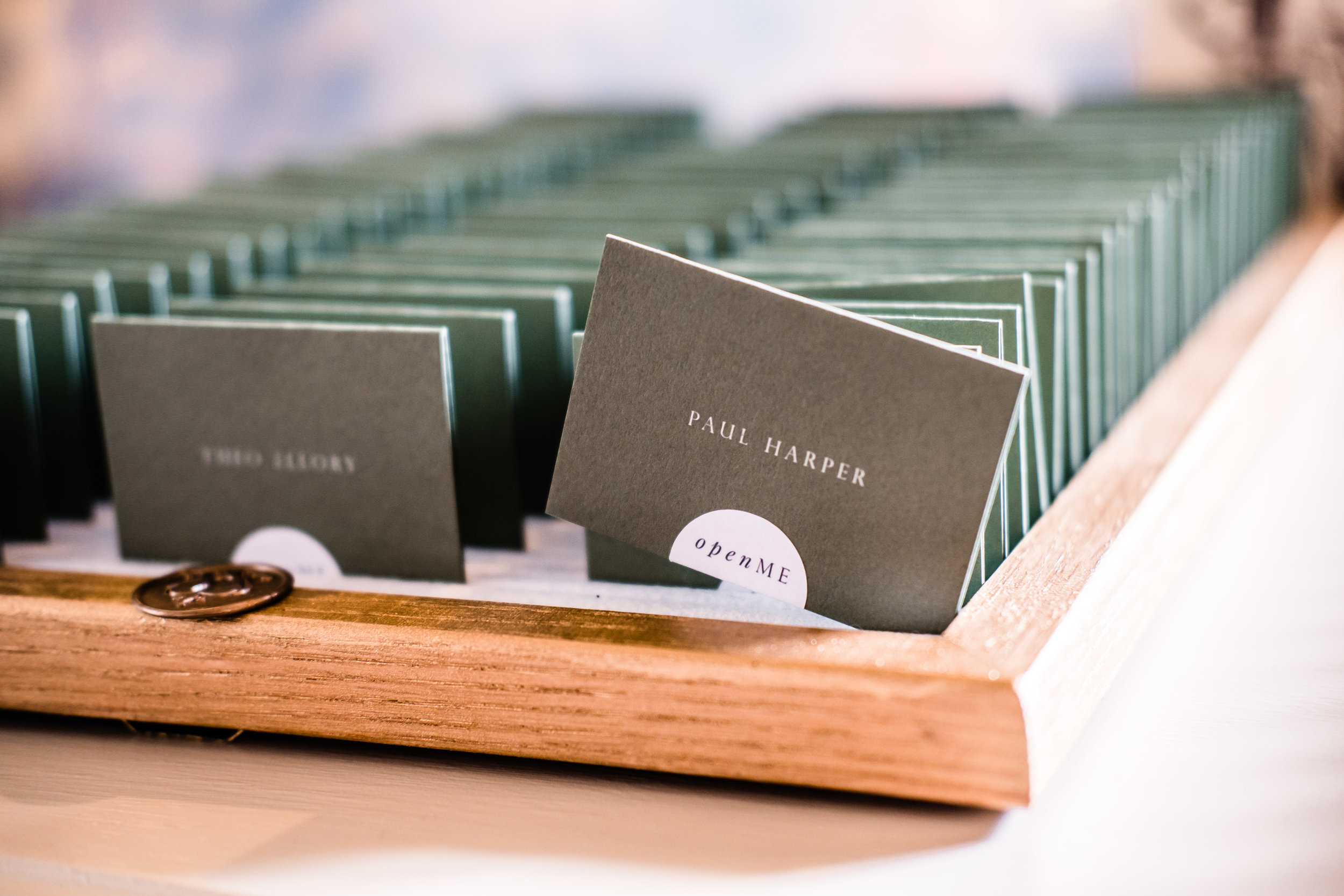 White ink print on forest green escort cards. Photo:  Helena Abraham