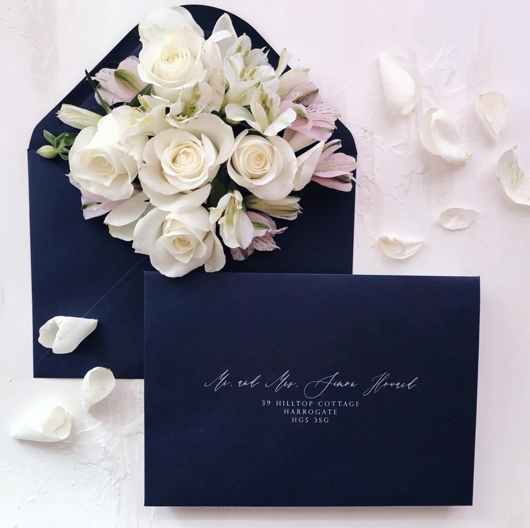 White ink printed navy envelopes