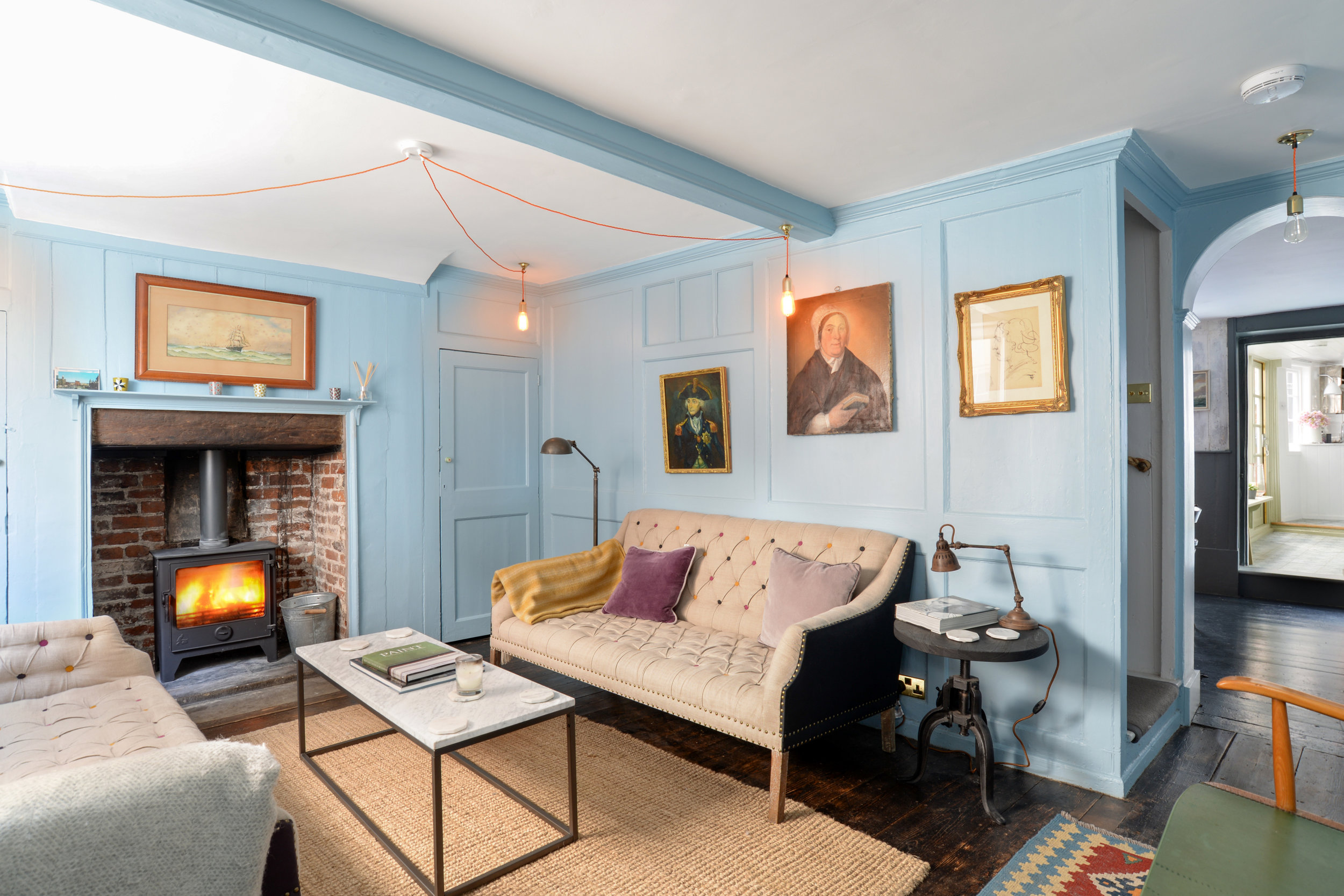 Ground floor - On the ground floor are two impressive Reception rooms - a grandiose living room and a resplendent dining room with cosy wood burner stocked with logs and kindling - and a delightful kitchen that overlooks the enclosed contemporary styled courtyard to the rear.The living room comes complete with an attractive open brick fireplace anddouble sash windows overlooking Farrier Street, two trendy three seater sofas and the most exquisite nautical themed artwork hung from the beautiful wood panelled walls.