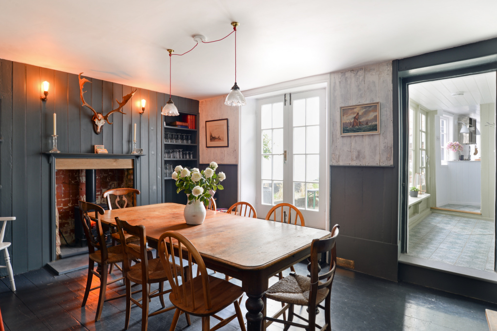 - The dining room table has seating for 8 with additional stools available should your party size be larger.