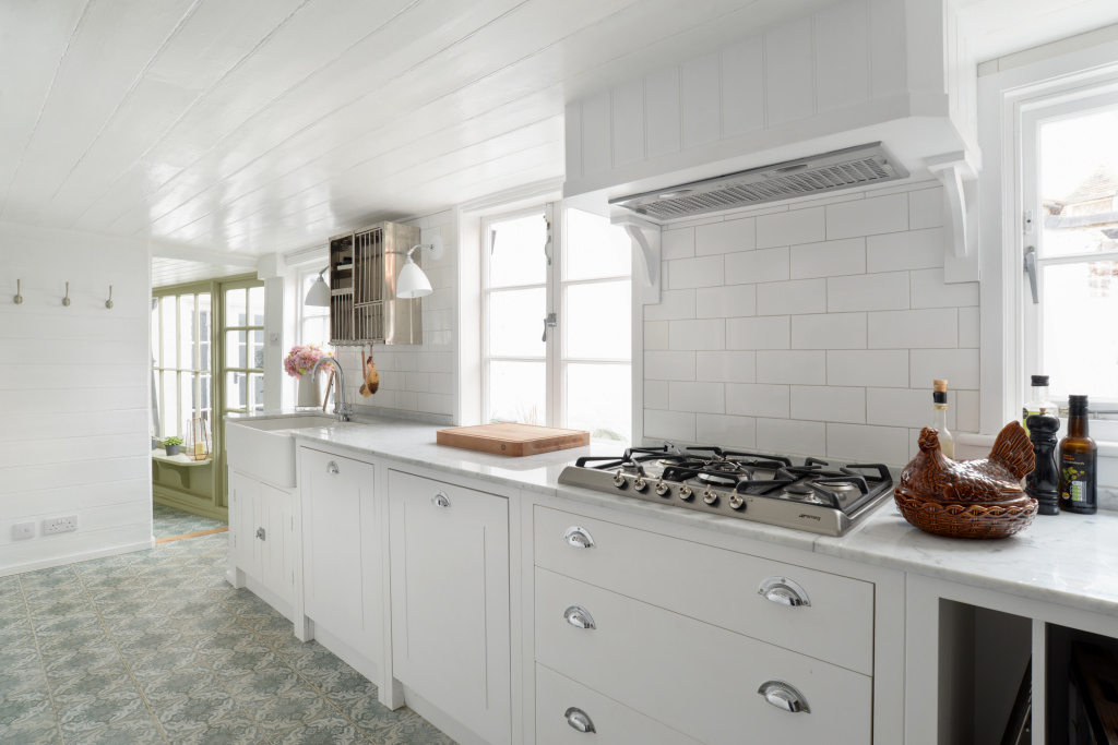 - There is a wonderfully light passageway leading to the kitchen that is really well-equipped with utensils, cookware and gadgets including a Nespresso Magimix.
