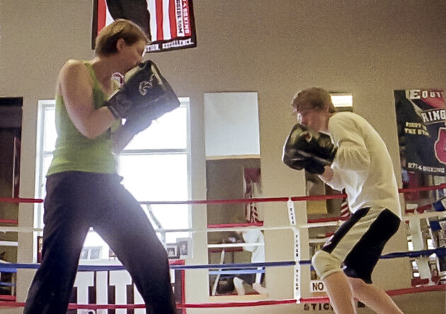 This is me with Ty—my first sparring parter. I miss you, buddy!