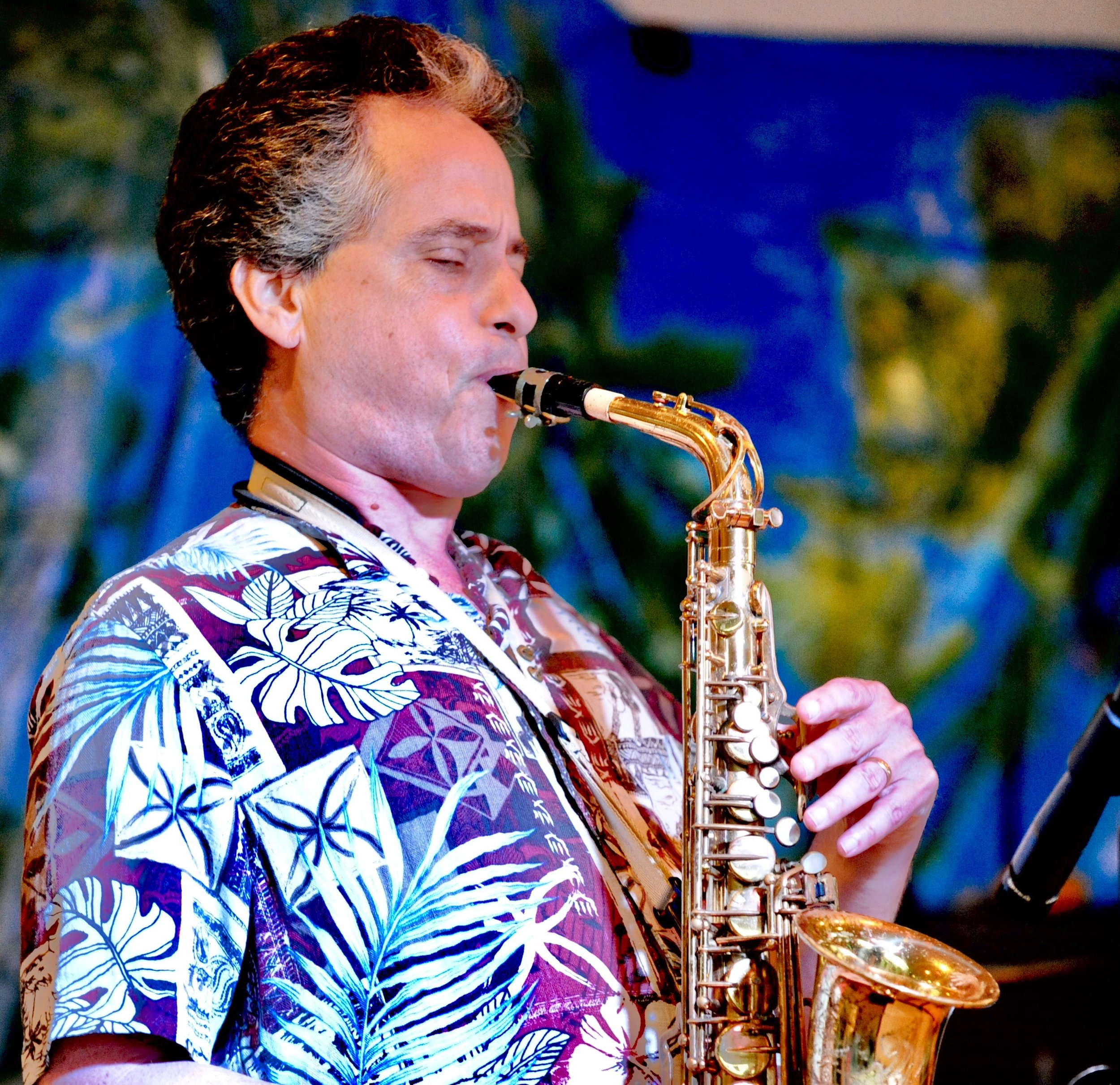 Michael Gedzelman    Saxophone   Plays so beautifully you can see the notes come out of his Sax and head off towards the sunset!