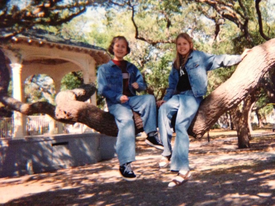 My sister and I. Not my childhood backyard but still an oak tree. OMG. So much denim.