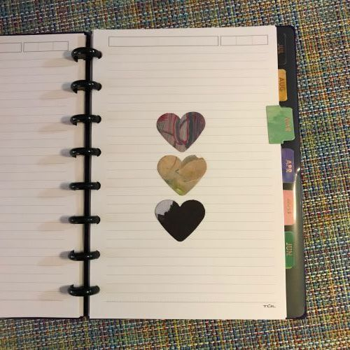 Punched Hearts and Month Tabs - Here's what I'm doing in my OLW journal this year. I purchased Erin Condren month tab stickers. Then, I just punched out some hearts. The month determines how many hearts go on each page. Three here means it's March!