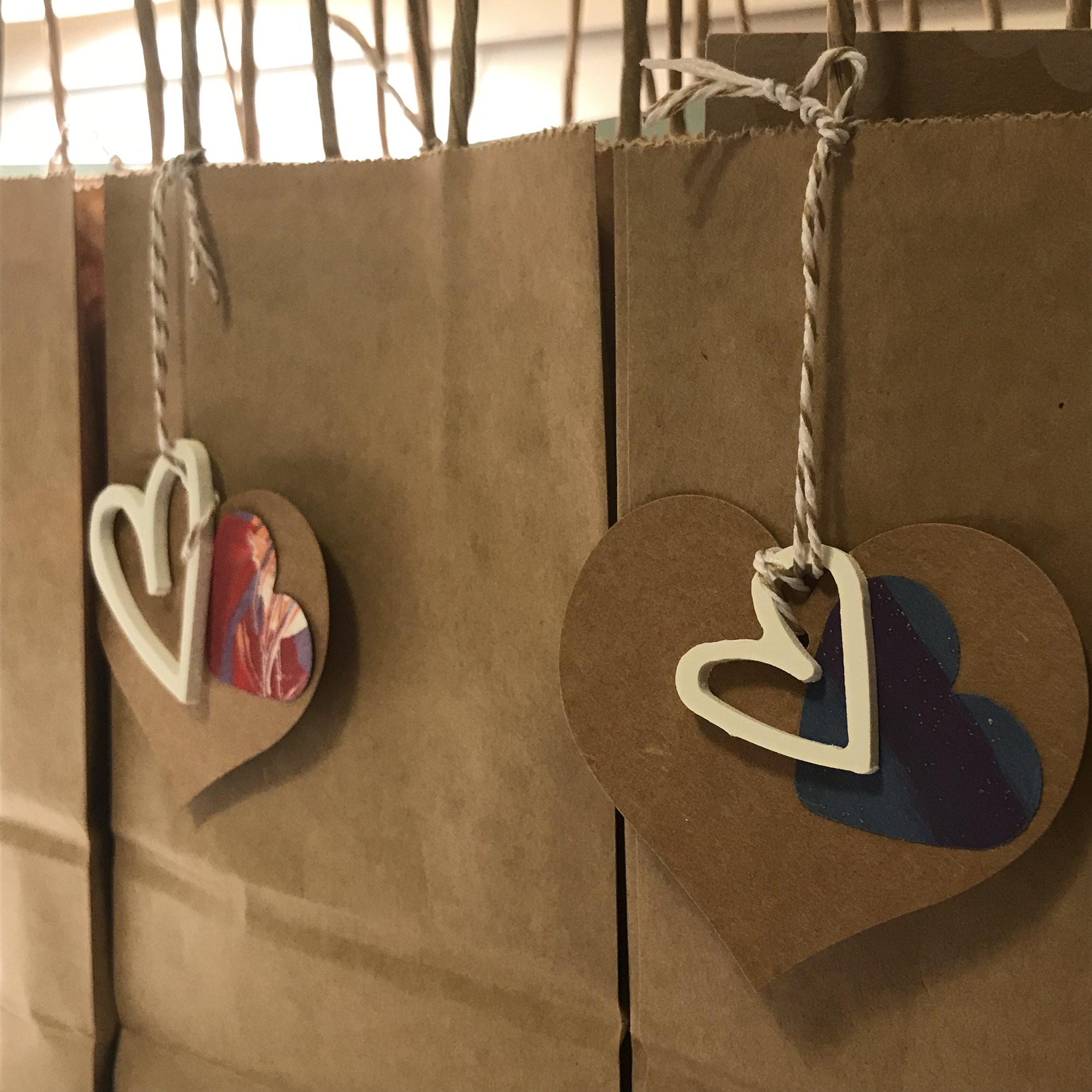 gift bags with writing goodies inside for every guest - (White recycled hearts created by Colleen Attara)