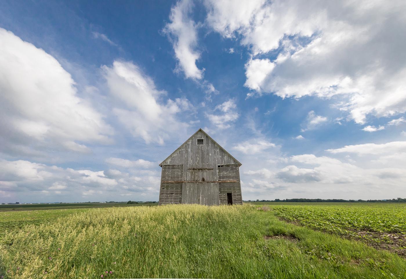Corn crib, soybean fields, and summer sky