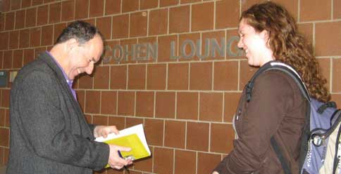 Poet Harry Clifton signs his book for a student, Montclair State University, October 29, 2009