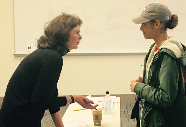 Poet Tara Bergin signing her book for a student from the Women Poets class, March 2018