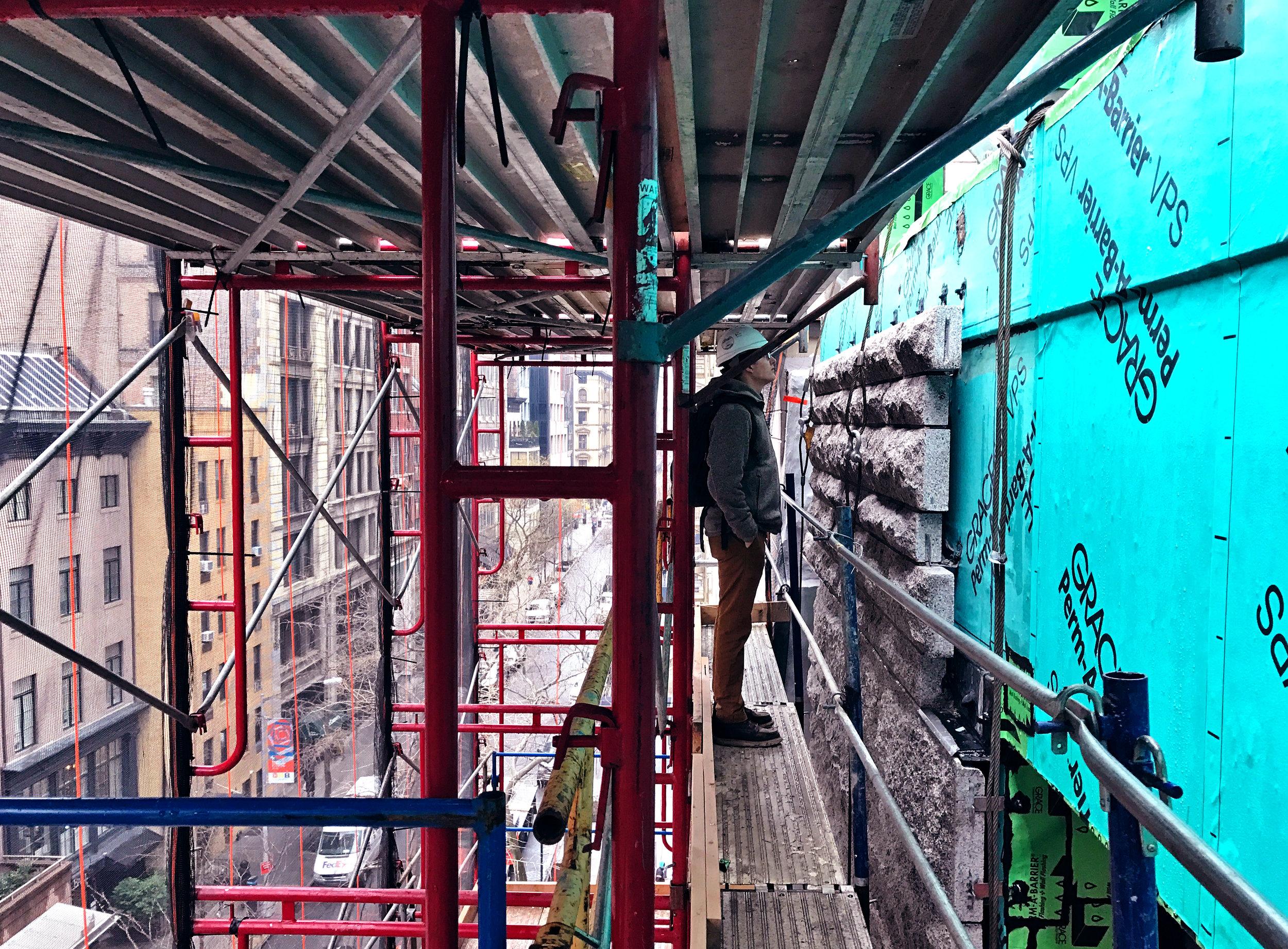 On site inspecting masonry work.