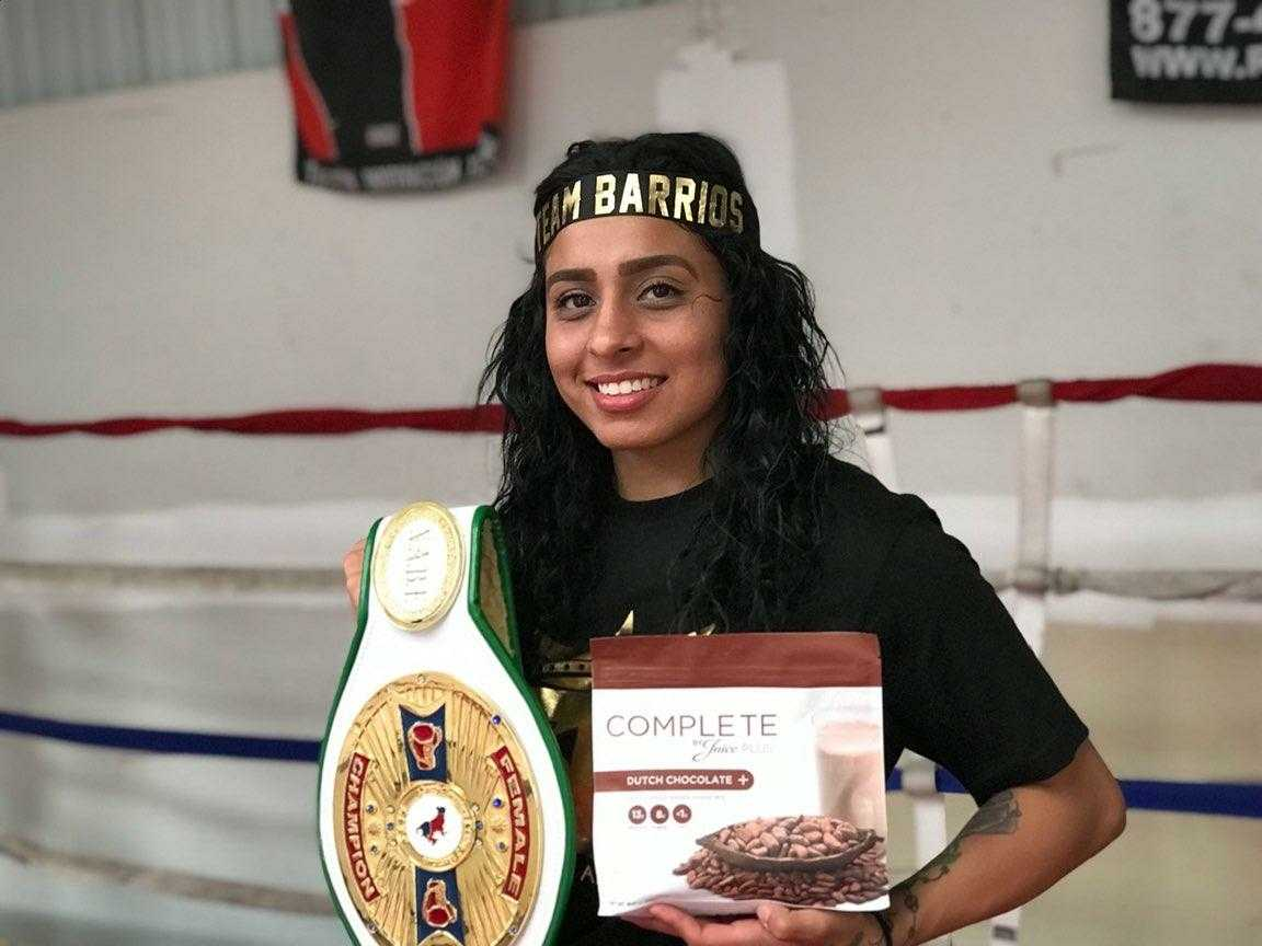 NAFB LIghtweight Champion, Selina Barrios, with protein of choice, JuicePlus Complete