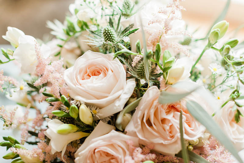 Peach and pink roses in wedding flowers bouquet