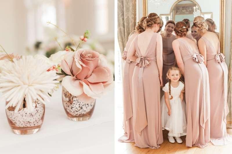Flower girl smiling in her white wedding dress at Rockbeare Manor