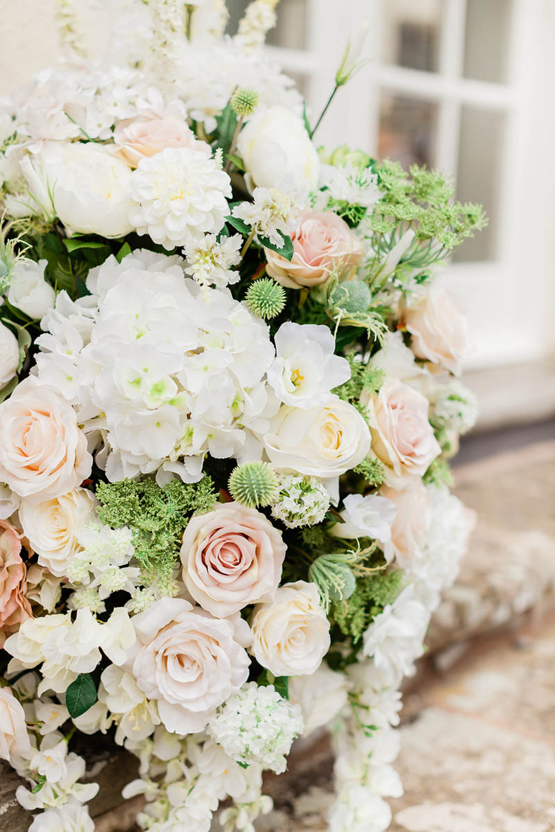 Large wedding ceremony flowers in ceramic pots at Rockbeare Manor in Devon