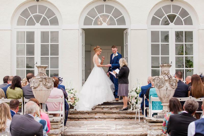 Grand entrance to Rockbeare Manor wedding ceremony steps