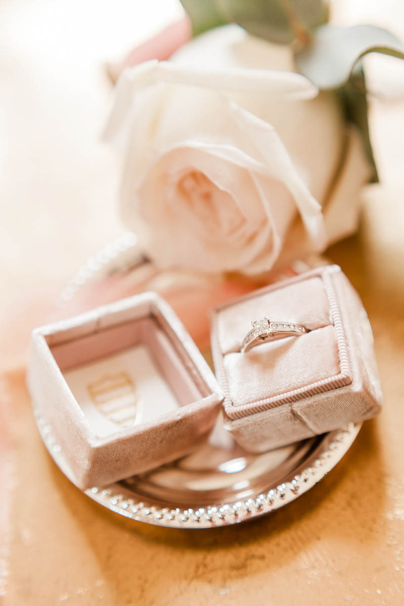 Light pink vintage engagement ring box in window at Rockbeare Manor