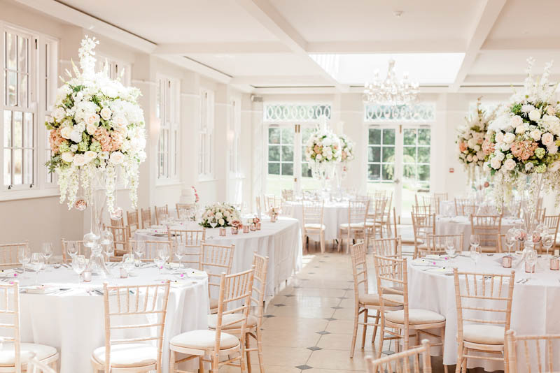 wedding day tables and chairs decorated with blush and white peonies at Rockbeare Manor