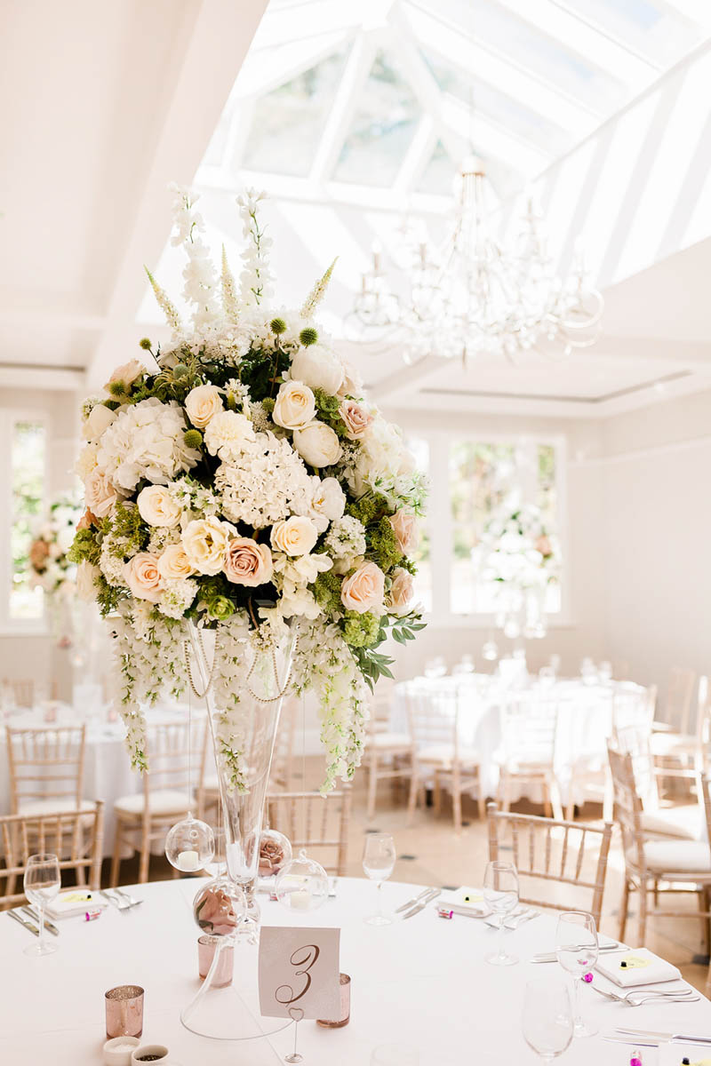 Elegant glass vase filled with white peonies and blush roses at Rockbeare Manor