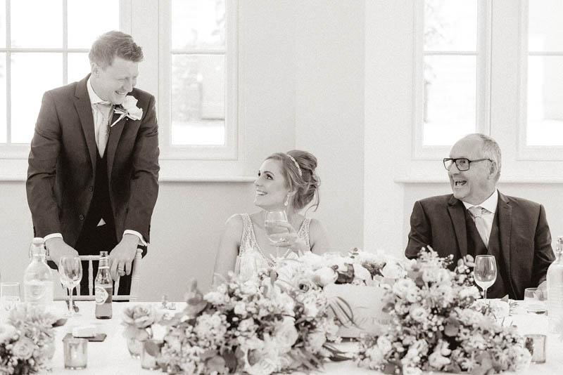 Groom speaking to his guests in the wedding breakfast room at Rockbeare Manor