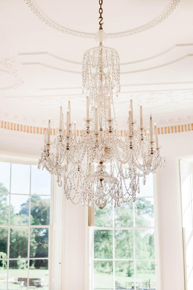 Crystal candle chandelier hanging over the dance floor at Rockbeare Manor in Devon