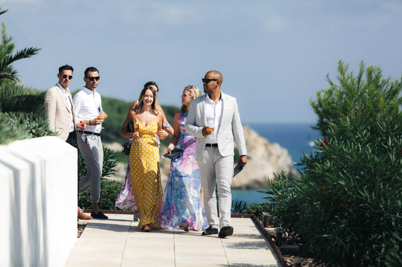 Guest walk along the pathway to ceremony at Masia Casa Del Mar in Sitges