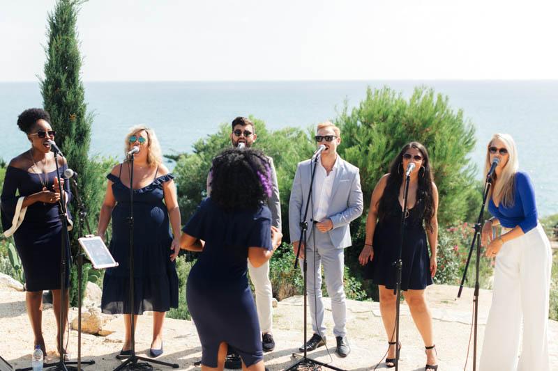 Gospeloke Choir sing whilst overlooking the sea in Barcelona