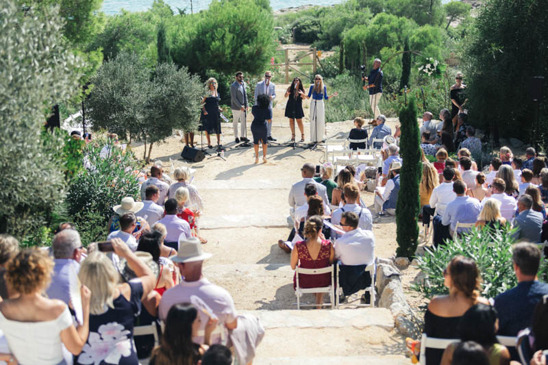 The ceremony site at Masia Casa Del Mar wedding guests getting to their seats