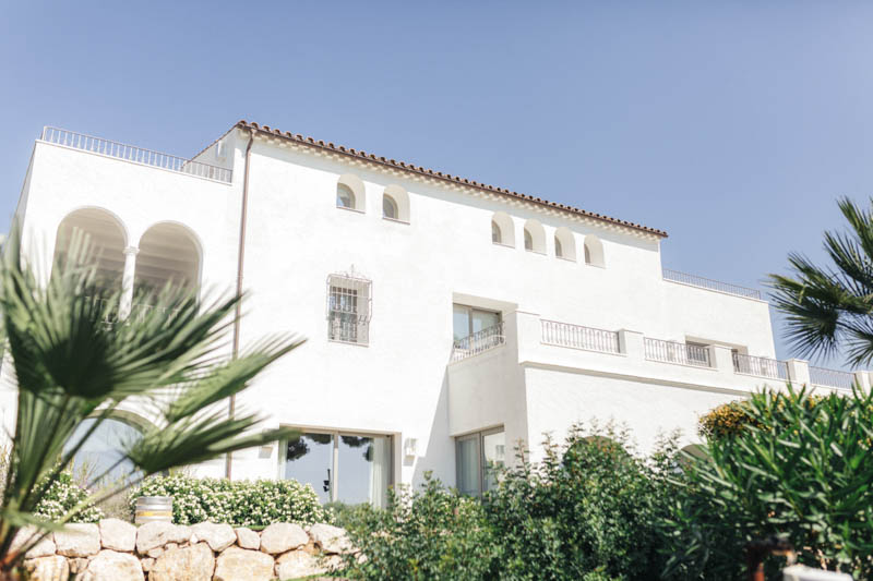 Outside view of white stone building Masia Casa Del Mar in Sitges, Barcelona