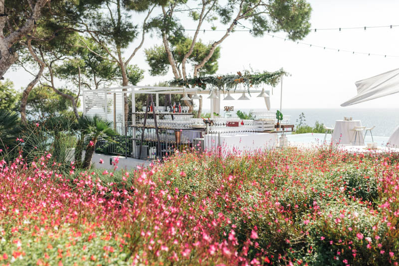 Pink flower garden overlooking the bar at the back of Masia Casa Del Mar in Sitges Barcelona