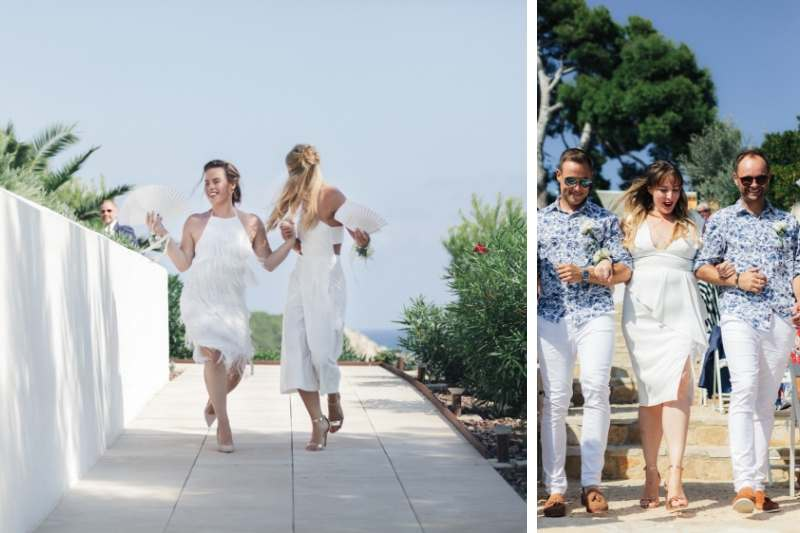 Groomsmen walk the bridesmaids down the aisle wearing all white and blue shirts by Ted Baker