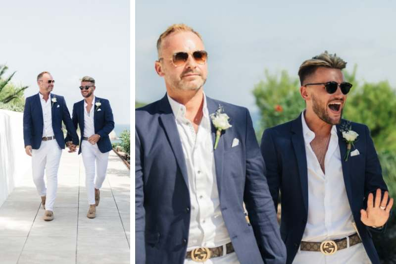 Gay couple holding hands and walking along the path outside Masia Casa Del Mar Sitges Barcelona