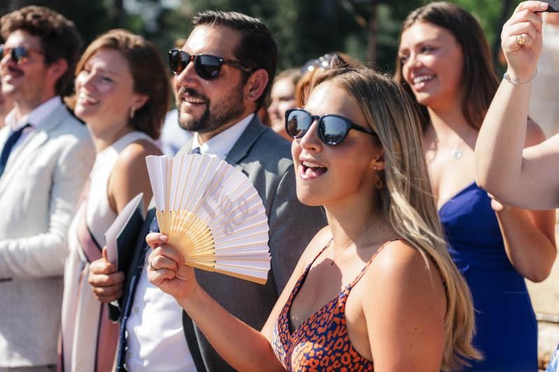 Guest waving fans at wedding celebration in Sitges, Barcelona
