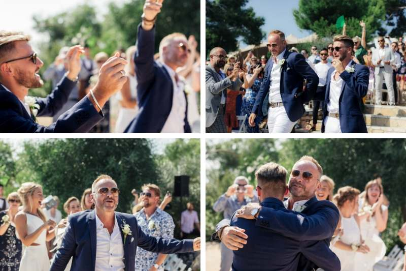Gay couple dancing at the entrance to their wedding day in front of guests
