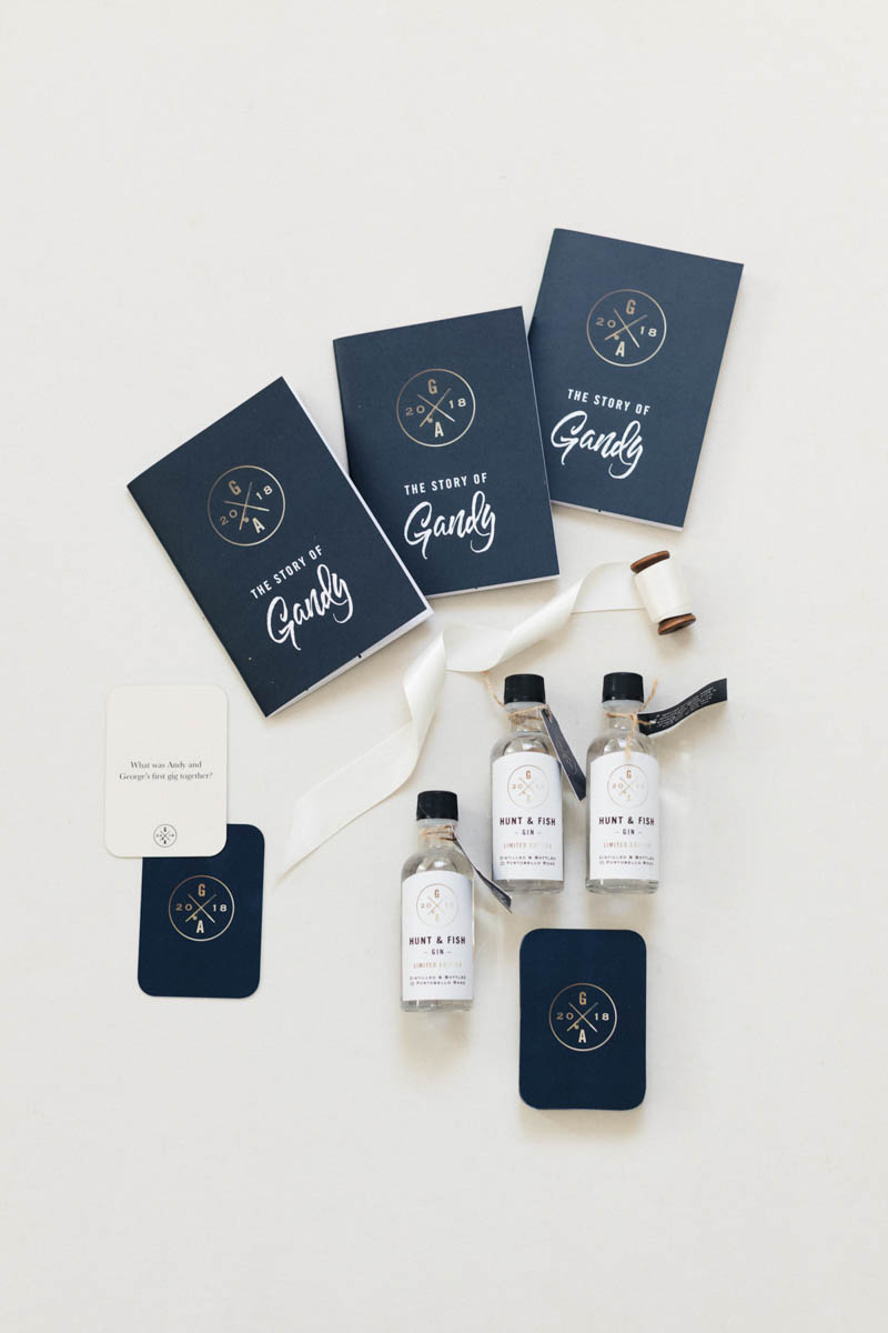 Luxury wedding invites and personal gin bottles with shield